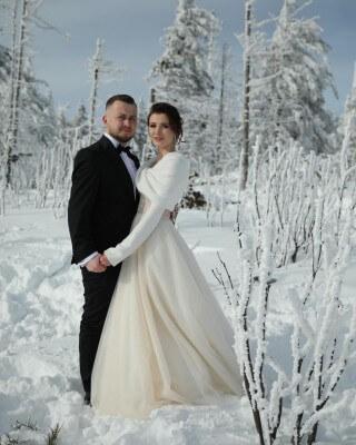 Mrs. Weronika with her husband in winter scenery