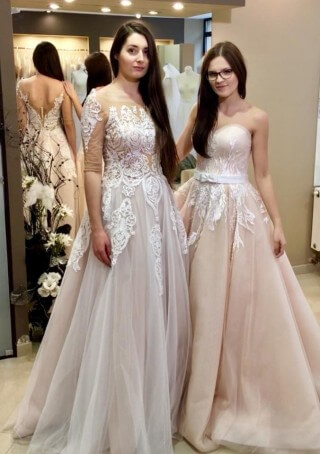 Beautiful friends and beautiful Lorange and Sutres wedding dresses